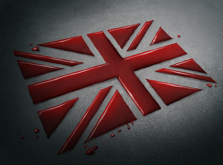 Tragedy in Britain concept as the blood of victims after a sad attack shaped as the flag of the British people as a news social issue concept. Stock Photo