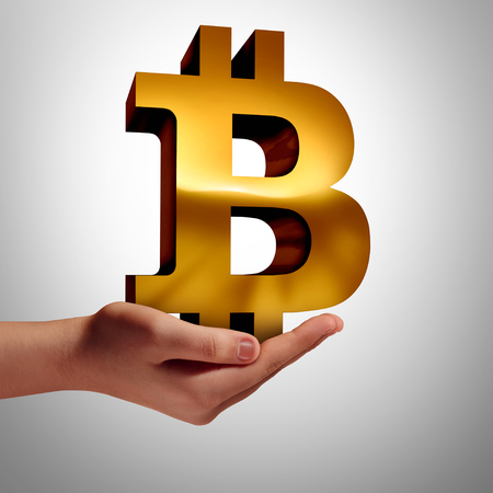 Bitcoin currency and symbol of cryptocurrency digital internet currency economic concept as a human hand holding online electronic money in a financial trade or transaction from a banking database market as a 3D illustration.