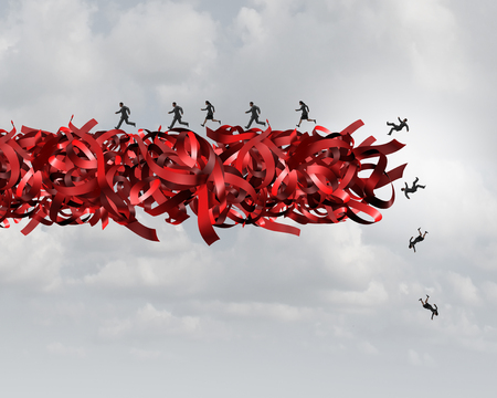 Red tape risk as a bureaucratic problem as employees running  and falling in bureaucracy and regulations as a business concept and symbol of government gridlock distress or corporate regulatory confusion. Stock Photo