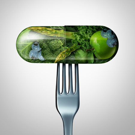 Natural food supplement concept as a pill or medicine capsule with fresh fruit and vegetables inside on a fork as a nutrition and dietary vitamin symbol for good eating health and fitness lifestyle with a 3D render.