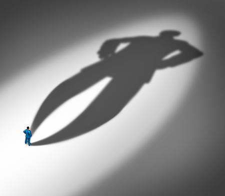 Project confidence as a businessman standing with a huge cast shadow as a metaphor for a confident personality and feeling of certainty in a 3D illustration style. Stock Photo