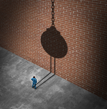 Believe in success as a businessman looking at a brick wall obstacle casting a shadow of a wrecking ball as a success metaphor to demolish negative barriers with 3D elements. Lizenzfreie Bilder
