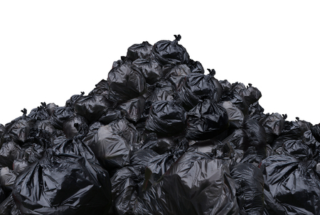 Garbage dump isolated on a white background as a pile of black plastic trash bags. Lizenzfreie Bilder