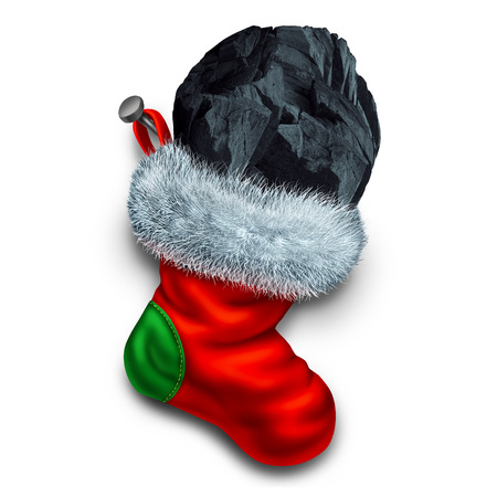 Chunk of coal in holiday stocking as a christmas symbol for naughty children gift or bad people seasonal winter present representing a punishment for bad behavior. Stock Photo