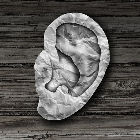 Human ear concept as a hearing sense health symbol for auditory medicine as a body part made with crumpled paper in a 3D illustration style. Standard-Bild