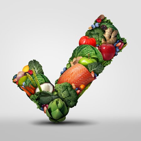 Approved healthy food and a symbol for raw organic fresh food as a check mark shaped with vegetables fruit nuts fish and beans as a dietary icon.