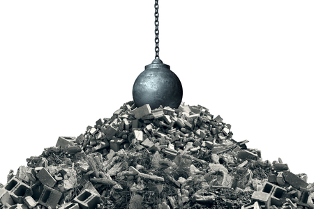 Knocking down and infrastructure makeover concept as a wrecking ball on debris from a destroyed structure as a renewal and renovation symbol with 3D illustration elements. Фото со стока
