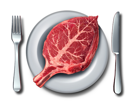 Eating organic food or paleo diet concept as a raw red steak shaped as a leaf on a plate with fork and knife with 3D illustration elements. Stock Photo