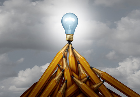 Creative peak and creativity height of success concept as a group of pencils shaped as a high mountain with a glowing light bulb on top as a 3D render.