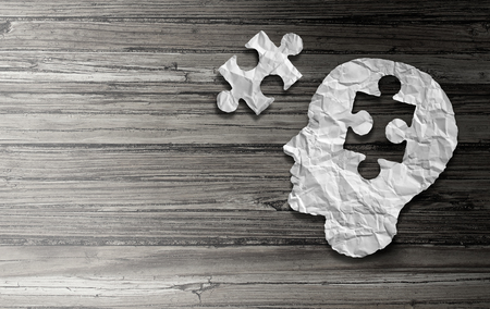 Parkinson disease and parkinsons disorder symptoms as a human head made of crumpled paper with a missing jigsaw puzzle representing elderly degenerative neurology illness in a 3D illustration style. Stock Photo