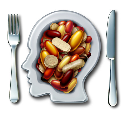Health supplements and vitamin supplement as a plate shaped as a human with a group of capsule and pills as a natural nutrient medicine and dietary treatment as a 3D illustration.