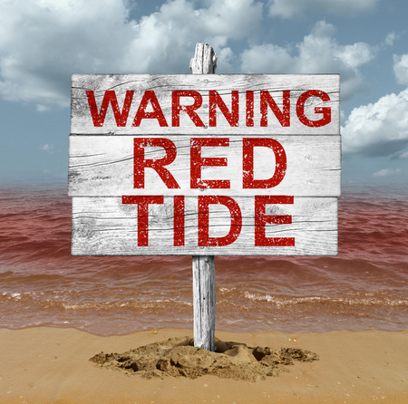 Red tide beach warning sign as hazardous natural toxin in the ocean
