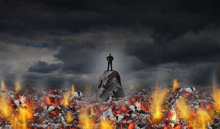Business adversity and courage or facing corporate pressure and feeling the heat concept as a businessman surrounded by hot coals in a 3D illustration style. Stock Photo