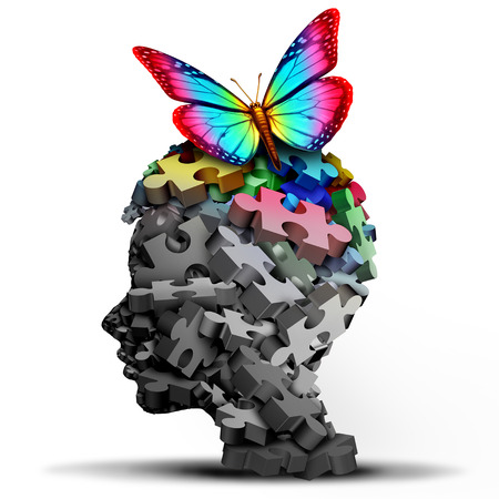 Autism idea and autistic developmental education disorder puzzle children symbol as a child special learning icon as jigsaw pieces coming together to form a young student head as a 3D illustration.