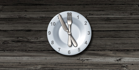 Intermittent fasting and calorie restriction or autophagy diet symbol nutrition concept promoting healthy benefits for prolonging lifespan with a clock icon on a plate with knife and fork with 3D illustration elements. Фото со стока