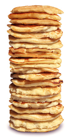 High stack of pancakes and a huge pile of delicious flapjacks.