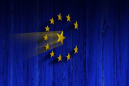 European Union concept as the symbols of the europe flag as ninja stars on a blue wooden wall as a 3D illustration. Foto de archivo - 123564644