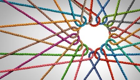 Unity and love partnership as ropes shaped as a heart in a group of diverse strings connected together shaped as a support symbol expressing the feeling of teamwork and togetherness. Stock Photo