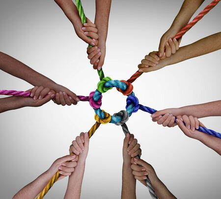 Diverse employees team meeting as a business concept for pulling together for work teamwork success and diversity symbol as a unified group working in unity.