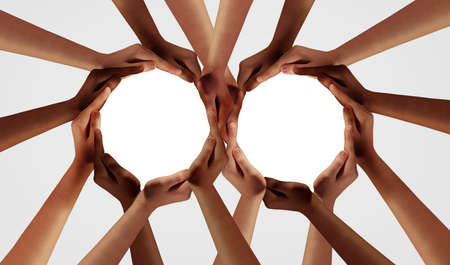 Group Unity and diversity partnership as hands in a group of diverse people connected together shaped as two teams in support circles as a symbol of connected teamwork and togetherness. Stock Photo