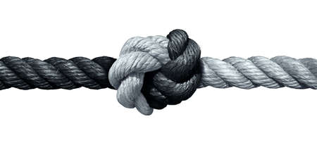 Trust concept and connected symbol as two different ropes tied and linked together as an unbreakable chain as a faith metaphor for dependence and reliance on a trusted partner for support and strength.