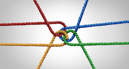 Connected team concept and unity or teamwork idea as a business metaphor for joining a partnership as diverse ropes tied together as a corporate symbol for cooperation and working collaboration. Banque d'images