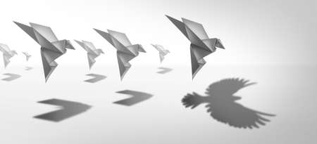 Ambitious leadership and leader vision or leading ambition as a business symbol for innovative imagination and success metaphor as an origami paper bird casting a shadow of powerful real wings in a 3D illustration style.