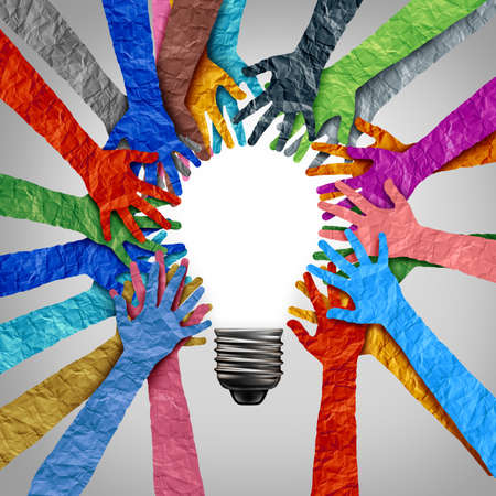 Global diversity ideas and diverse society thinking together as a team or a group of people uniting together joining hands into the shape of a motivational light bulb as a community metaphor with 3D elements. Foto de archivo