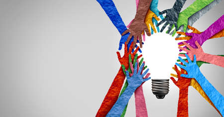 Diverse society thinking together and team ideas as group of people coming together joining hands into the shape of an inspirational light bulb as a community diversity metaphor with 3D elements. Stock Photo