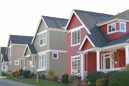 row houses: case colorate in una fila Archivio Fotografico