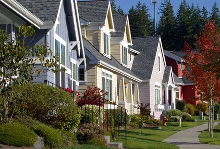 suburbs: A row of colorful newer homes nicely landscaped. Great for real estate needs. Stock Photo