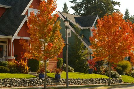 Colorful newer homes nicely landscaped. Great for real estate needs. Stock Photo