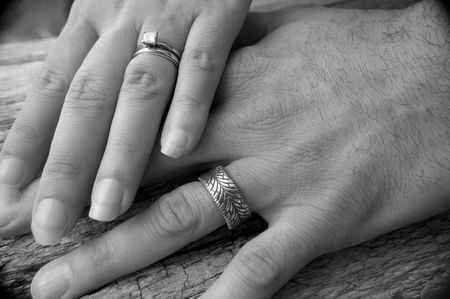 couple holding hands: Wedding Bands and Hands