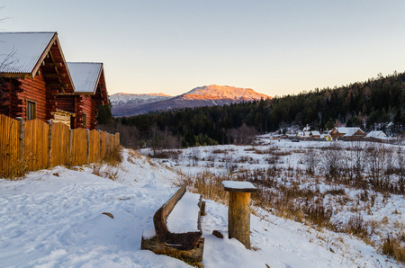 Village houses in the Ural mountains in winter photo