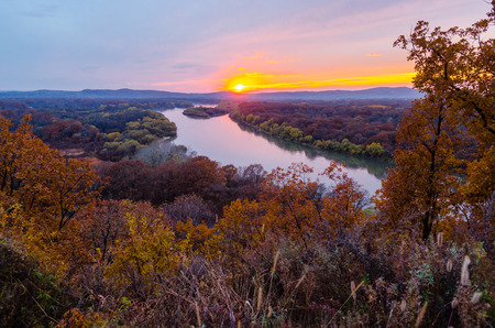 red mountain open space: Sunset over the river Ussuri. Primorsky Krai. Russia