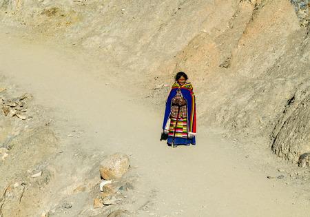Tibetan woman commits bark around Mount Kailash. Tibet Editorial