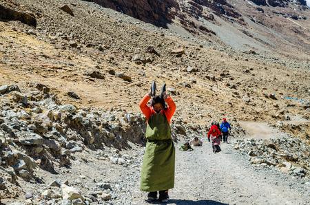 commits: Tibetan woman commits bark around Mount Kailash. Tibet Editorial