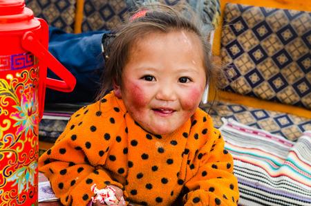 tibetan house: Tibetan little girl lives at the foot of Mount Kailash. Tibet Editorial