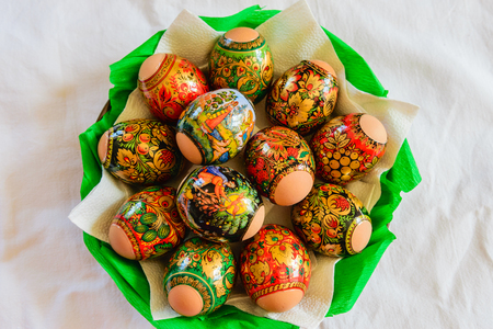 easter candle is burning: Easter eggs on a plate Stock Photo