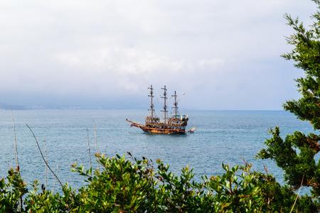 sailing boats: Sailing ship floating in the sea Stock Photo
