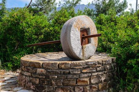 millstone: Circular stone for grinding grain. Turkey