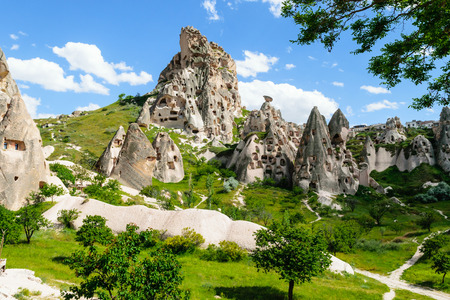 dwellings: Natural fortress of Uchisar, riddled with man-made dwellings and dovecotes, dominates the skyline of Cappadocia.