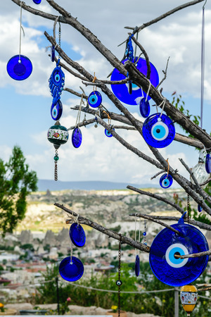 superstitions: Evil eye charms hang from a bare tree in Cappadocia, Turkey