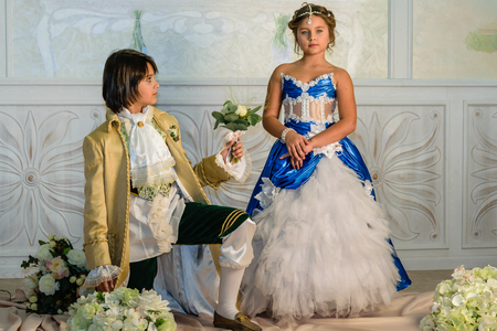 french fancy: Boy and girl  in a beautiful dress with flowers
