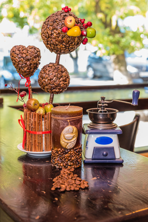 Coffee grinder, candle. coffee tree and coffee beans