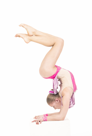 Studio photography of a girl performing acrobatics. Studio shot on white background,isolated image. Editorial