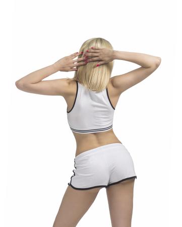 Jeune femme est engagée dans la forme physique et le yoga. Studio tourné sur fond blanc. L'image isolée Banque d'images - 83427803
