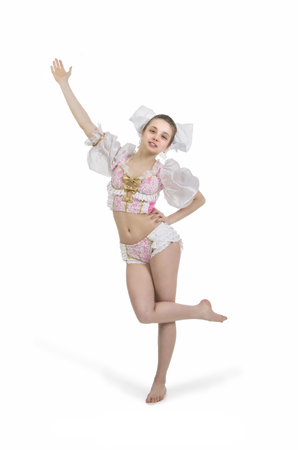 puppets: A young, smiling girl. A circus artist in a puppet suit. Studio shot on white background, isolated image. Stock Photo
