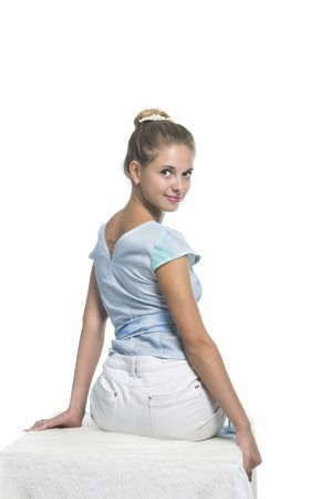 Emotional beautiful girl posing in Studio on a white background. The isolated image.motions of beautiful girl.