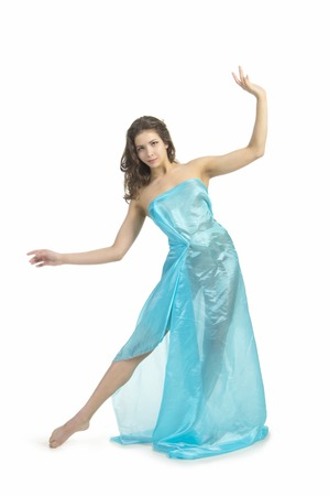 The girl in the blue tunic posing in the Studio. The isolated image on a white background.
